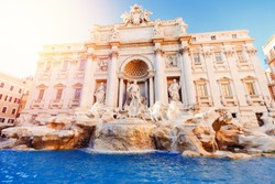 Trevi Fountain sunset baroque architecture and landmark Rome Italy.