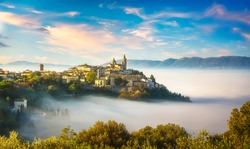 Trevi picturesque village in a foggy morning. Perugia, Umbria, Italy, Europe.