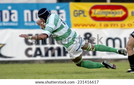 TREVISO, ITALY-MAY 28, 2005: Treviso rugby player jumps to score a try during the italian final rugby match, Treviso vs Calvisano, in Treviso.