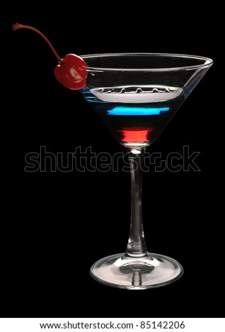 Tri-color cocktail martini with a cherry on a black background