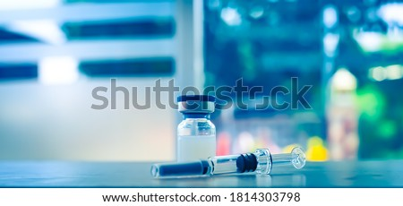Trial vaccine coronavirus deverlopment vial dose flu shot drug needle syringe,medical concept vaccination hypodermic injection treatment disease care hospital prevention immunization illness disease.