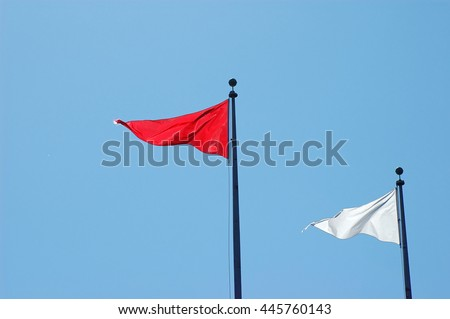 triangle flag against blue sky #445760143