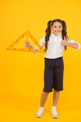 Triangle right angle. Knowledge day. Schoolgirl school uniform hold big ruler geometry school lesson. Math stem architecture faculty. Measuring equipment. Kid cute school student study mathematics.