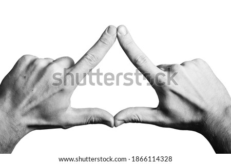 Photo of  Triangle shape made with fingers. Two hands connected together background. Illuminati triangle. Fingers sign isolated on white.