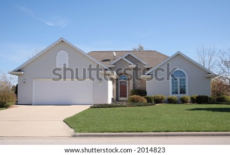 Triangles abound on this nice one-story home - stock photo