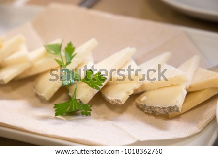 Triangles of Manchego cheese for appetizer Spain