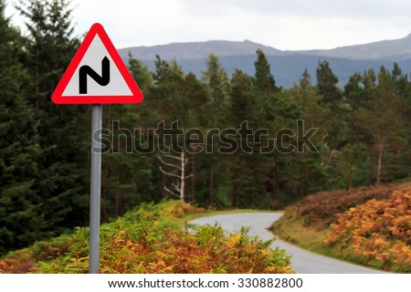 Triangular road sign warning of bends in the road #330882800