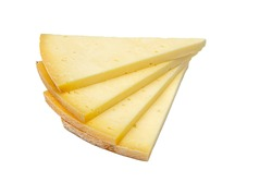 Triangular slice of old cheddar cheese. Piece of yellow cheese with sliced pieces on white background.