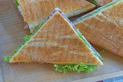 Triangular toast sandwiches diagonally cut fast food