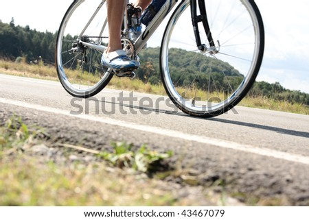 triathlete on bicycle with slight motion blur