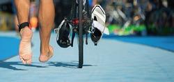 Triathlon bike the transition zone,detail of the bare feet