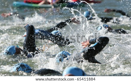 Triathlon swimmers churning up the water.