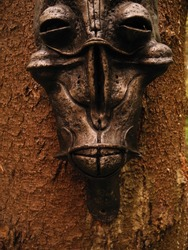 Tribal fantastic masks in the shaman forest