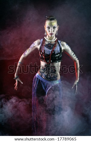 tribal girl dancing in fog