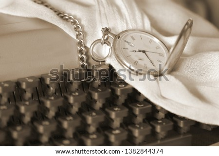 tribute to Ansel Adams, Sepia Photo, Sepia artistic still life of old typewriter and old Silver chain watch with engraved lid with an old steam locomotive
