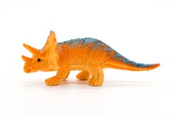 Triceratops toy model on white background