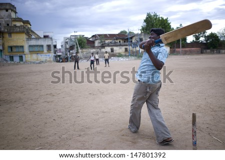 TRICHY, INDIA - 16 AUG: A group of high school students have a cricket game on the school playground on July 16, 2008. Cricket is a national game of India, where everyone loves this sport.