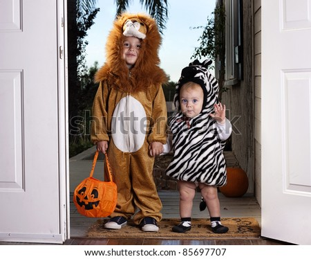 Trick or Treat; adorable children dressed up for Halloween