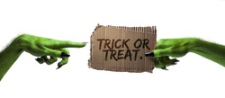 Trick or treat. green witches or zombie monster hand holding a halloween card sign