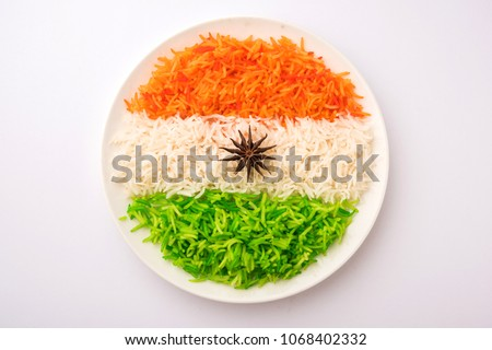 Tricolor Tiranga Rice for indian Republic and Independence day, served in a ceramic plate, selective focus #1068402332