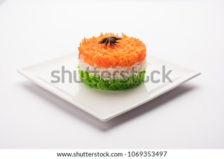 Tricolor Tiranga Rice for indian Republic and Independence day, served in a ceramic plate, selective focus #1069353497