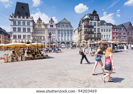 TRIER, GERMANY-  JUNE 28: Market square. This cental square came into existence in 10th century and marked by replica of original stone cross dates by 958 year, in Trier, Germany, on June 28, 2010