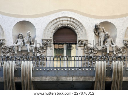 Trieste, Italy - Art nouveau balcony decorated with statues of children  in playful mode #227878312