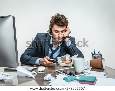 Trifle away one\'s time / modern office man at working place, sloth and laziness at work concept
