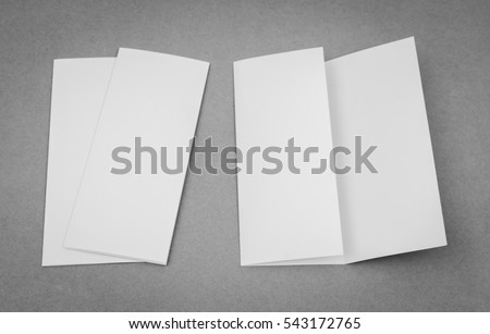 Trifold white template paper on gray background #543172765