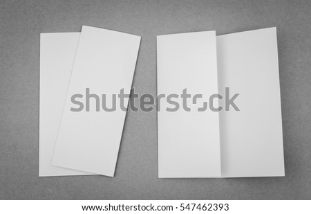 Trifold white template paper on gray background