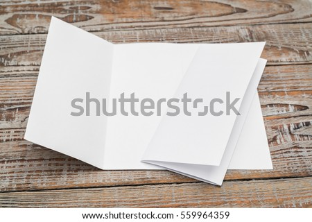 Trifold white template paper on wood texture #559964359