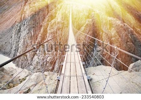 Trift Bridge, the longest 170m pedestrian-only suspension bridge in the Alps. Switzerland