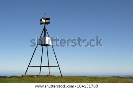 Trig Station against a blue sky background