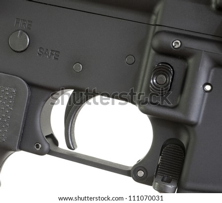 Trigger on a modern rifle with the fire controls ready to fire