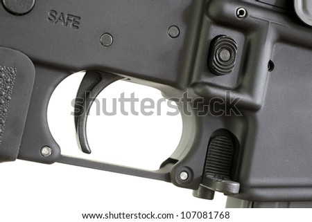 Trigger on an assault rifle with the safe indicator above