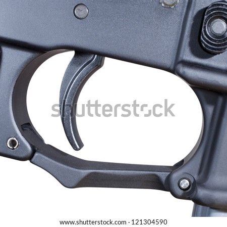 Trigger that is found on an AR 15 isolated on white