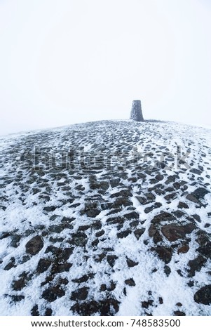 Trigonometrical point on the summit of Mam Tor in Winter. Peak District, Derbyshire, UK