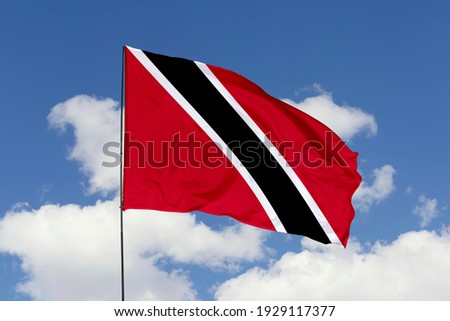 Trinidad and Tobago flag isolated on sky background with clipping path. close up waving flag of Trinidad and Tobago. flag symbols of Trinidad and Tobago. Stock photo ©