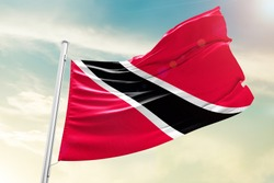 Trinidad and Tobago national flag cloth fabric waving on the sky  - Image