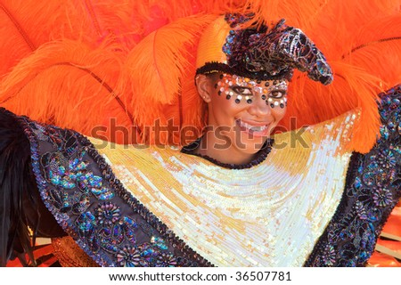 TRINIDAD WEST INDIES - FEBRUARY 2: An unidentified costumed participant takes part in Trinidad Carnival celebrations during Junior Parade of the Bands February 2, 2008 in Trinidad W.I.