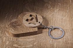 trinket house and heart symbols on wood backround