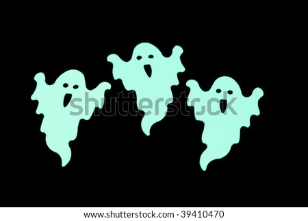 trio of green glow in the dark halloween favors - stock photo