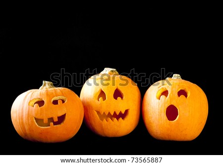 Trio of Jack-o-lanterns on black