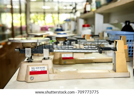 Triple beam balance In the chemistry laboratory. #709773775