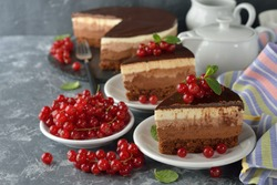 Triple chocolate cake decorated with currants and mint