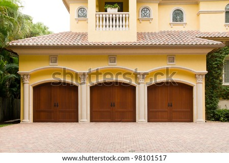 Triple garage with wooden doors