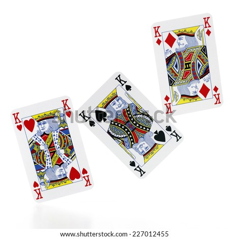 Triple King (poker cards) isolated on white background