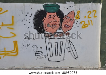 TRIPOLI, LIBYA. 5 NOVEMBER. Libyans celebrate the liberation from the Qaddafi regime with graffiti ion walls at Bab Al Azizia on 5 November 2011 in Tripoli