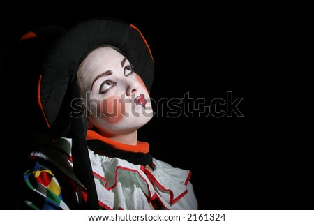 clowning makeup. girl with clown makeup