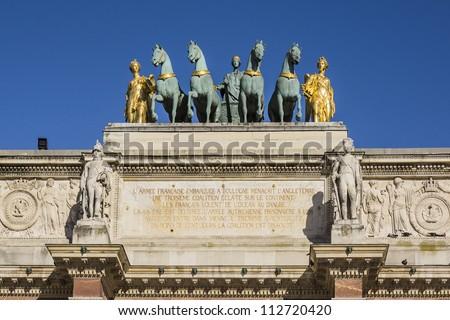 Triumphal Arch (Arc de Triomphe du Carrousel) at Tuileries gardens in Paris, France. Monument was built between 1806-1808 to commemorate Napoleon's military victories.